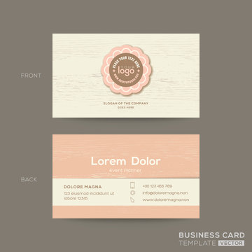 business card for gift shop, coffee or bakery shop. Pink pastel name card design template with wooden background
