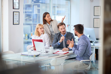 Businesspeople presenting ideas to clients at his office.