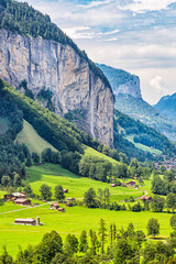 Switzerland - The Valley Known as Lauterbrunnen on a Summers Day - High Cliffs with the Alps in the Background