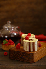 three chocolate cake with fresh raspberries