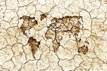 World map embed on dry cracked surface earth, water and earth background concept