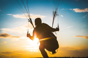 Paraglider flying. Sunset. Take off. Top view Wall mural