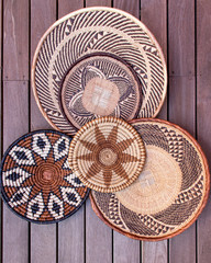 African grass baskets on a wooden background