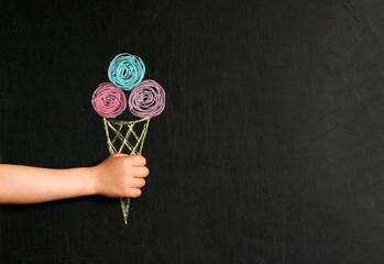 ice cream drawn with crayons on the blackboard