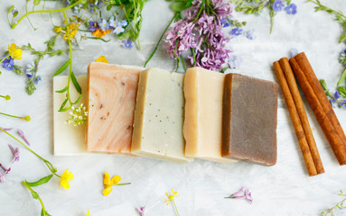 Obraz Natural handmade soap bars with organic medicinal plants and flowers.Homemade beauty products with natural essential oils from plants and flowers, top view closeup photo - fototapety do salonu
