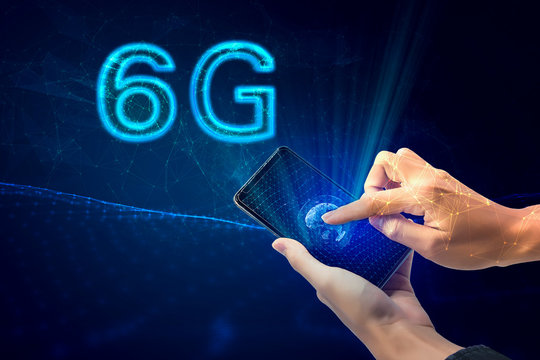 Creative connection background, mobile phone with hologram The concept of 6G network, high-speed mobile Internet, a new generation network has a wireless speed limit mixed media