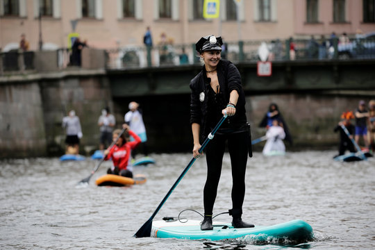 A paddler takes part in the Fontanka-SUP stand up paddle boarding festival inSaintPetersburg