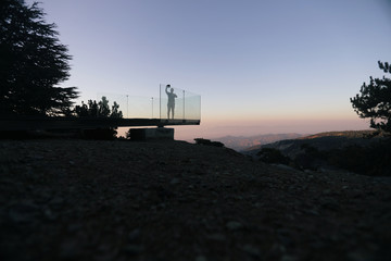 A tourist takes a selfie at an observation point in Troodos Mountain