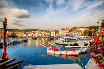 Wall Mural - Cityscape with marina in bay of Cassis resort town. France, Provence