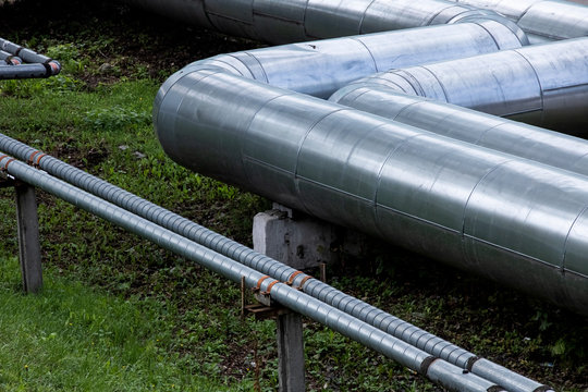 Metal water pipes above the ground close up