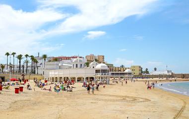 Playa La Caleta Beach at Cadiz, Andalusia. Spain.  Unrecognizable Beach Goers and Swimmers.