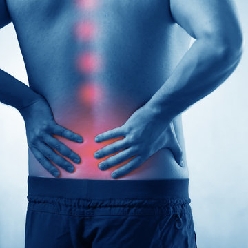 Man suffering from acute pain in spine back