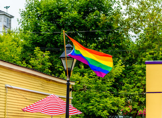 LGBT Pride Rainbow Flag Flying High and Proud over a Streetlight