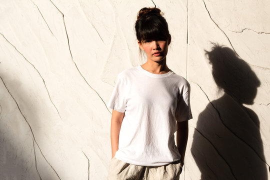 White T-shirt mockup with asian girl fashion portrait - shirt mockup model copy space white background