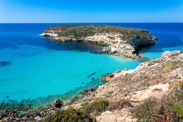 "Lampedusa Island Sicily - Rabbit Beach and Rabbit Island  Lampedusa ""Spiaggia dei Conigli"" with turquoise water and white sand at paradise beach."