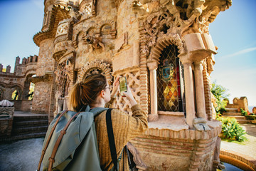 Woman photographing Spanish architecture
