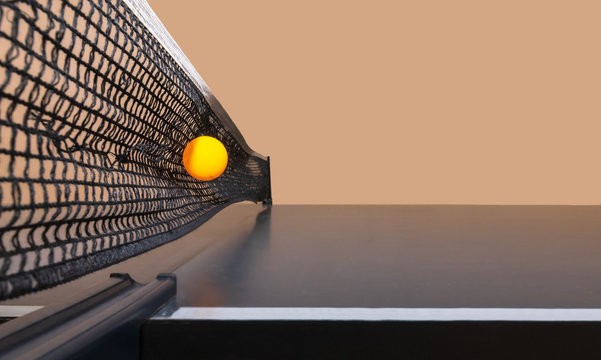 Tennis game. Ping-pong in rustic style on beige background. Tennis ball in the net.