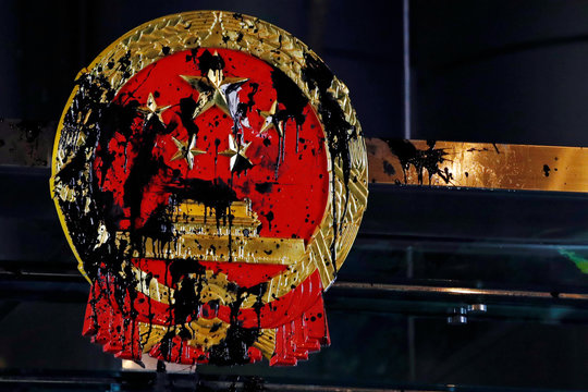 A National Emblem splashed with paint after anti-extradition bill protest is seen outside Chinese Liaison Office in Hong Kong