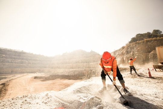Miners working in dusty and baking hot.