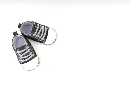 Baby shoes on white background. Selective focus