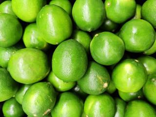 Wall Mural - Fresh green lime pile in harvest season