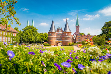 Wall Mural - Historic town of Lübeck with famous Holstentor gate in summer, Schleswig-Holstein, northern Germany
