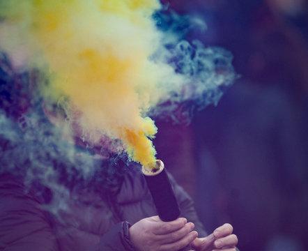 Colorful yellow smoke bomb