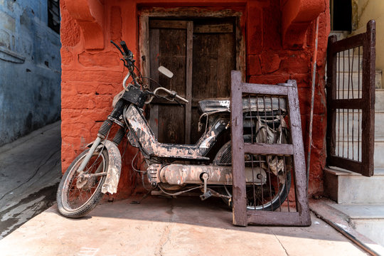 The old motorbike and the window