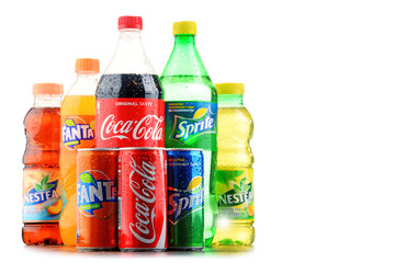 Bottles of assorted Coca Cola Company soft drinks