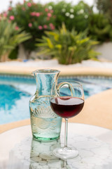 Carafe of water and glass wine