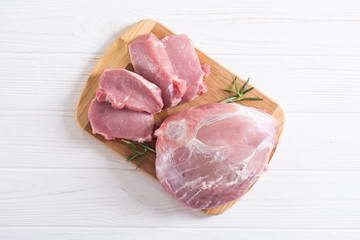 Raw pork meat on wooden background Wall mural