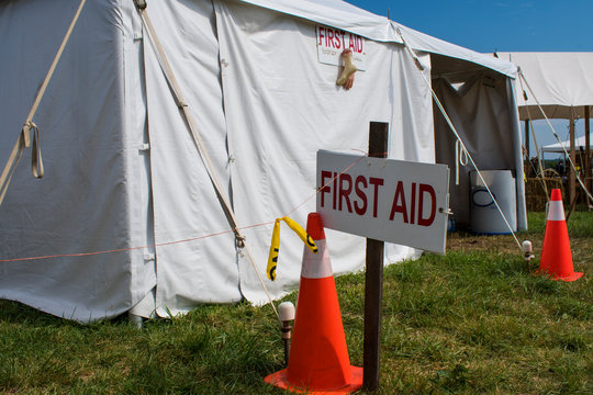 First aid sign in front of tent