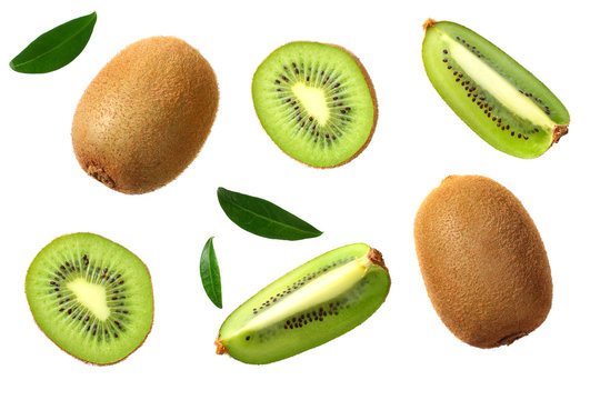 kiwi fruit with slices and green leaves isolated on a white background. top view