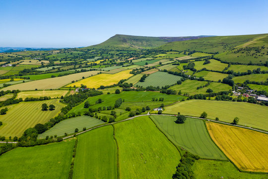 Aerial view of green fields and farmlands in rural Wales