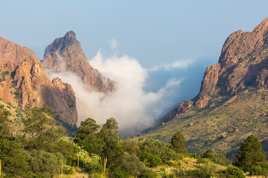 Clouds passing over 'The Window' in the Chisos Basin during the day in Big Bend National Park (Texas).