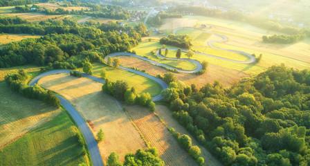 Fototapeta Drone aerial view - windy road in summer