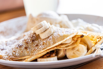 Walnuts and sliced bananas crepe