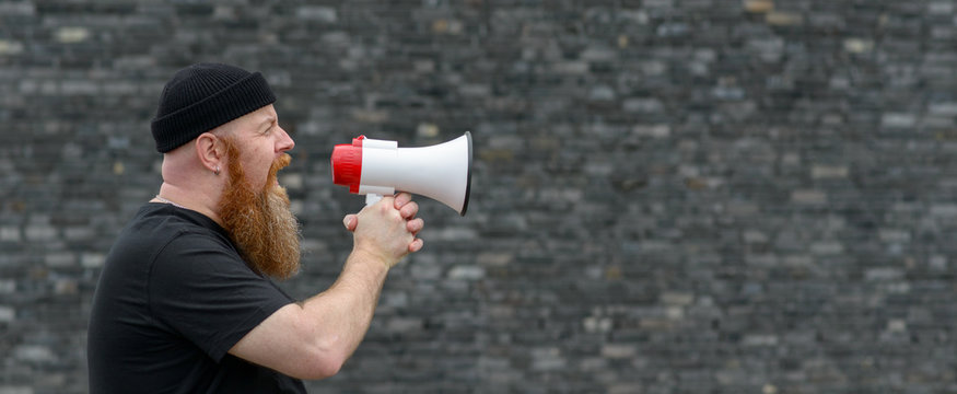 Man with a grievance yelling into a megaphone