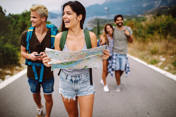 Group of backpackers and young friends traveling and having fun together