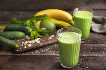 Glasses of healthy smoothie on wooden table