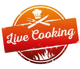 Button Siegel Live Cooking zerkratzt mit Flammen, Kochmütze und Besteck