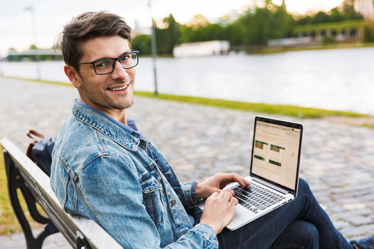 Handsome young man dressed casually spending time outdoors