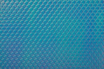 Holographic mermaid fish scales iridescent faux leather texture abstract background.