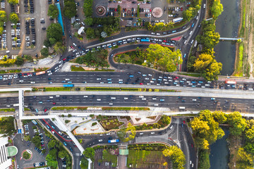 Top down view of road traffic in the heart of Jakarta business district along the Sudirman avenue in Indonesia