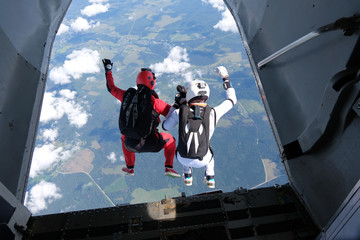 Skydiving. Two skydivers are jumping out of a plane.