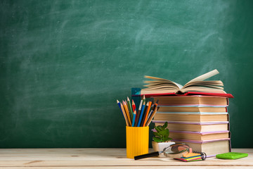 Education and reading concept - group of colorful books on the wooden table in the classroom,...