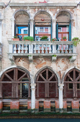Fototapete - Exterior of old residential building in Venice, Italy
