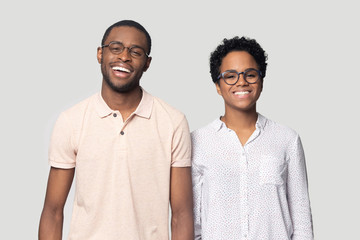 Smiling ethnic couple laugh posing for picture in studio