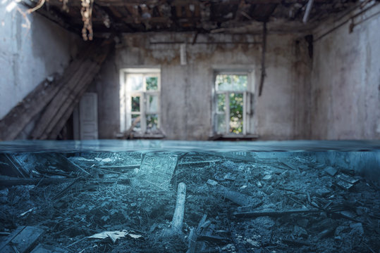 The concept of abandoned and flooded housing and natural disasters. Focus on foreground