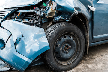 Obraz selective focus of damaged blue auto after car accident - fototapety do salonu